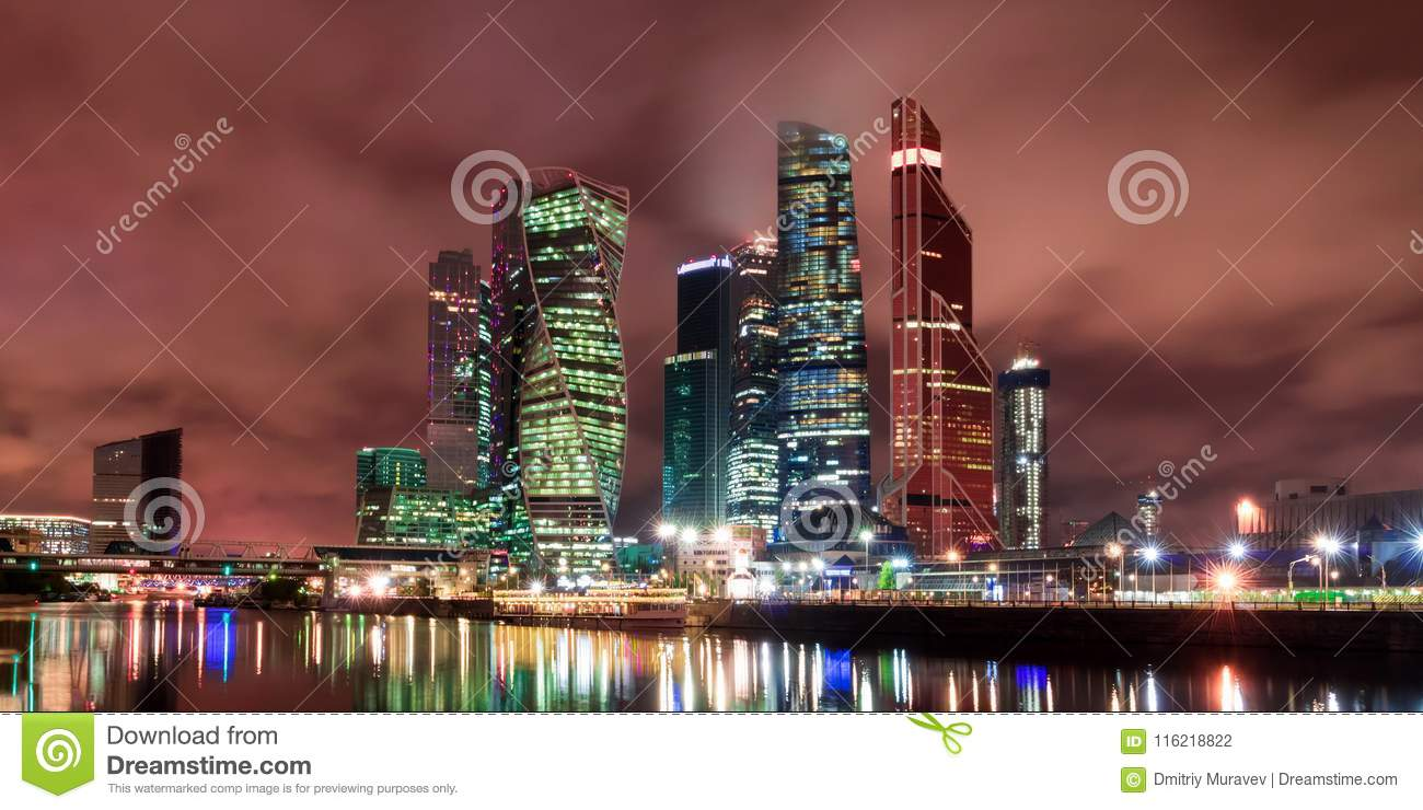 The city of Moscow at night, view from the embankment of the Moscow River to the business district. Architecture and landmark of M