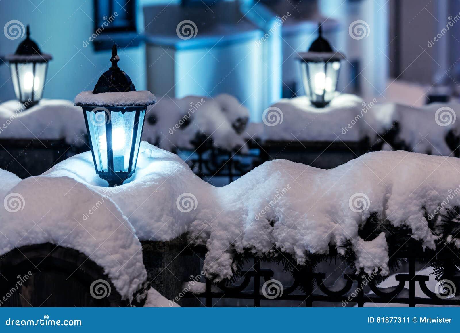 City Night Scene With Street Christmas Lights During Snowfall Stock ...