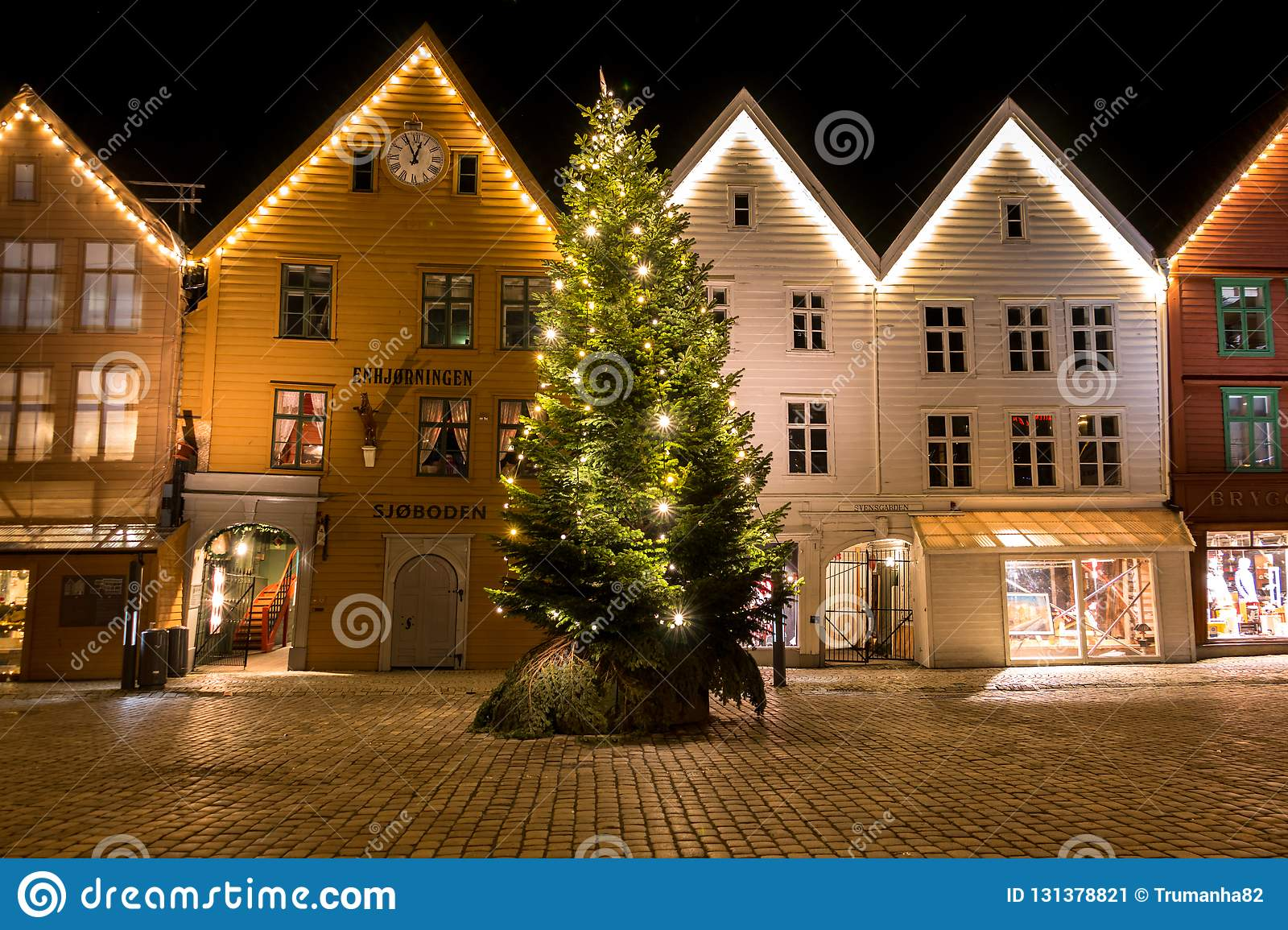 City Scene With A Glittering Christmas Tree In Front Of