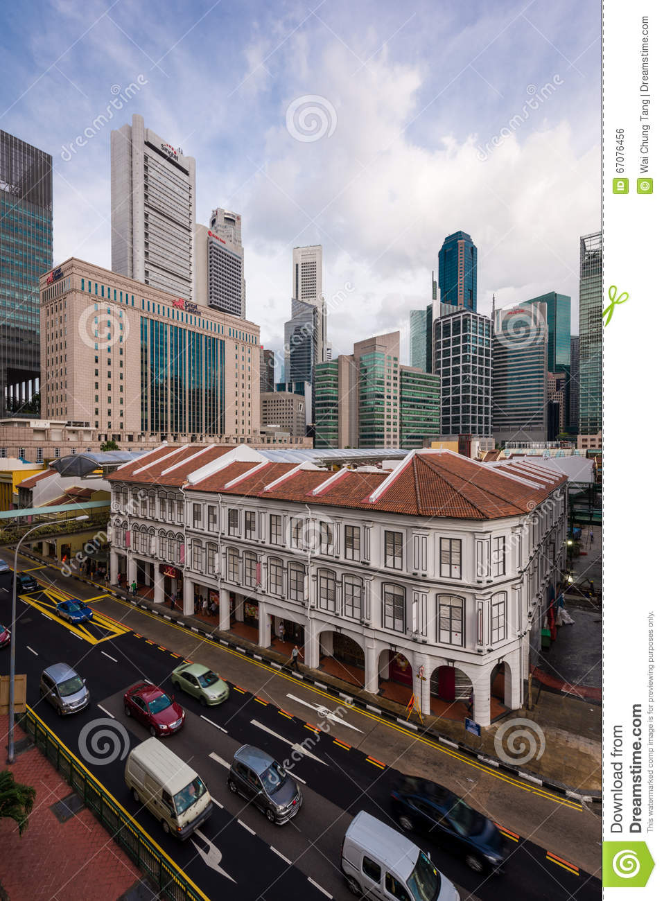 Historical Buildings And Skyscrapers Along A Busy Street In Singapore