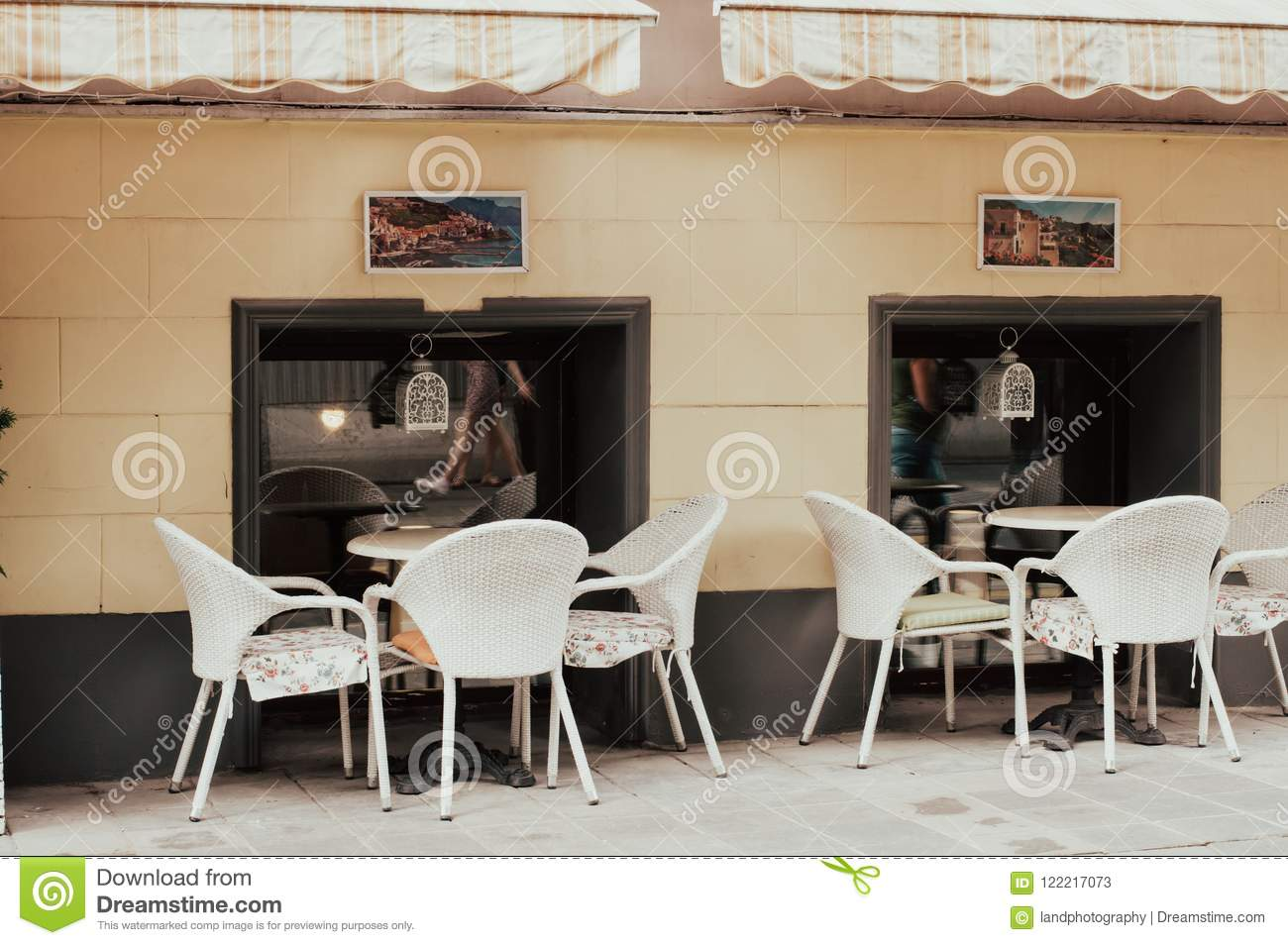 City Vintage Cafe In The Street Restaurant Exterior And Interior Tables With White Chairs Outdoors