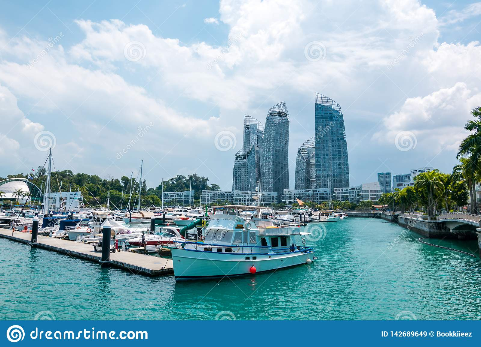 The cityscape with boats view of Keppel island in Singapore.
