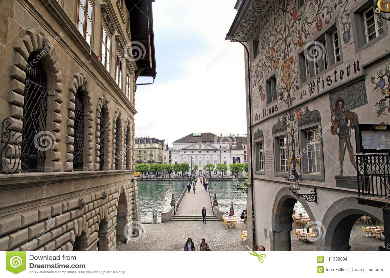 Cityscape with view of medieval houses with murals and bridge o