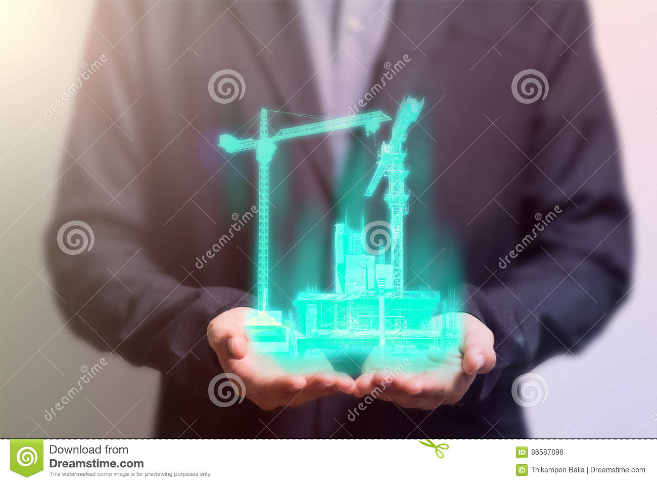 Civil engineer holding a hologram crane building construction