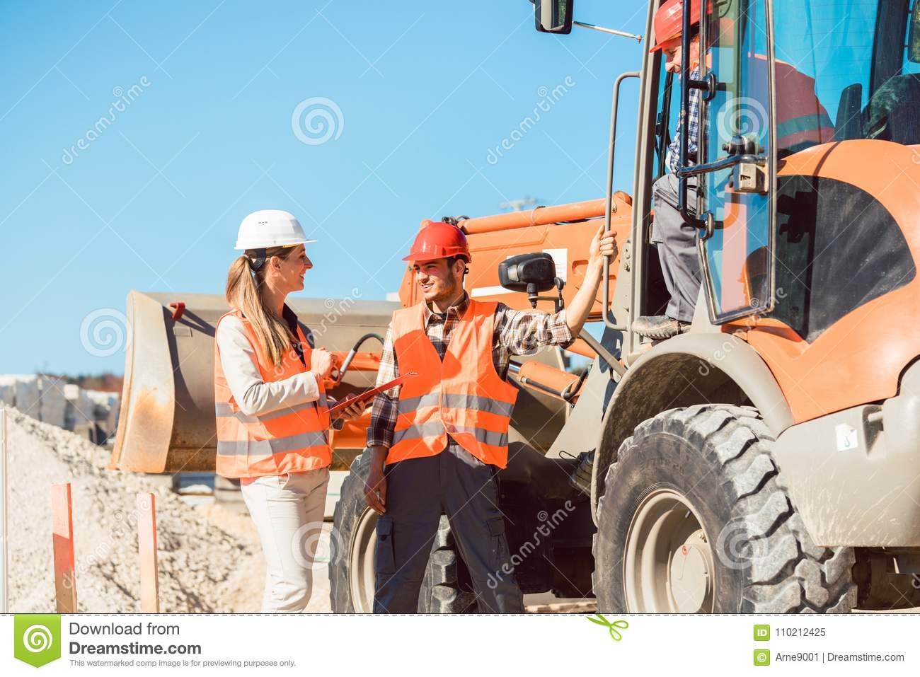 Civil Engineer And Worker Discussion On Road Construction