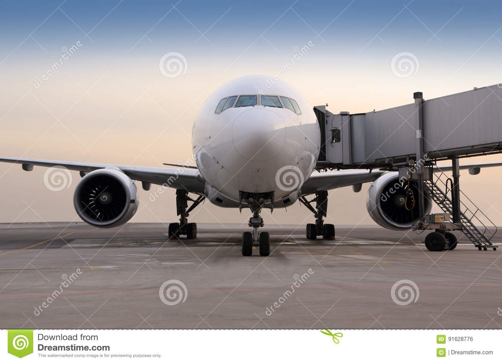 Civil passenger airplane standing near the gate