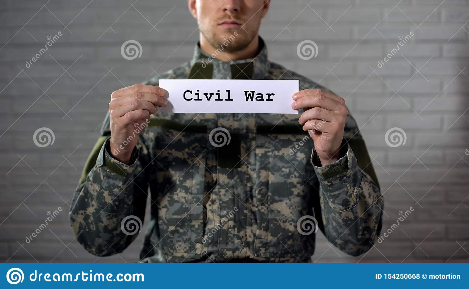 Civil war word written on sign in hands of male soldier, cruelty and death