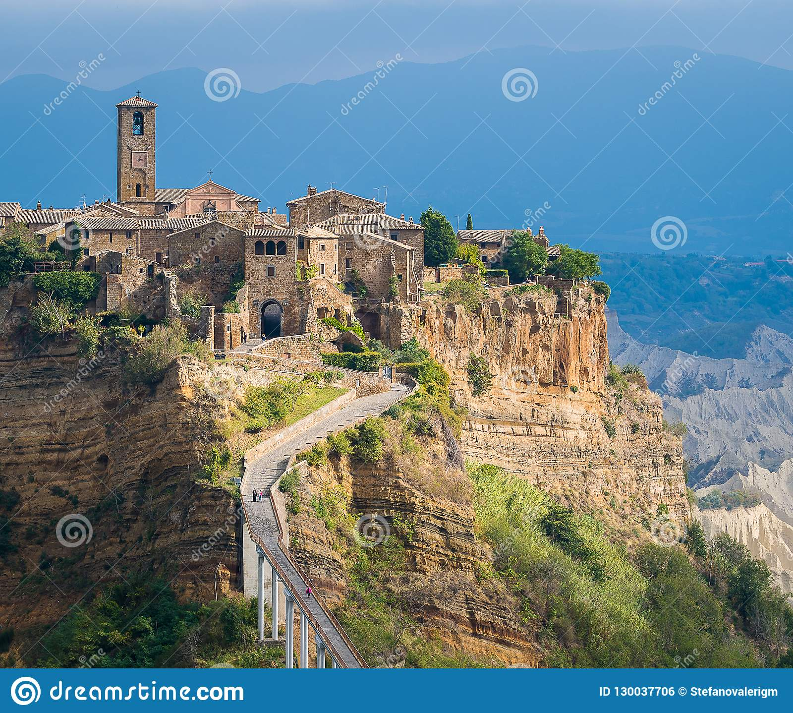 The famous Civita di Bagnoregio hit by the sun on a stormy day. Province of Viterbo, Lazio, Italy.