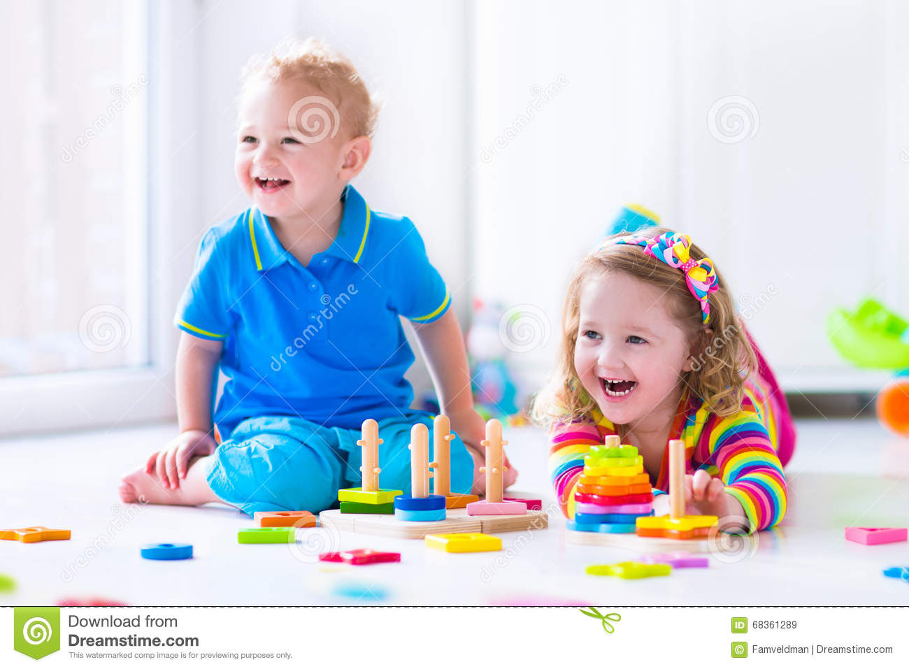 Toddler Toys Photography : Cjildren playing with wooden toys stock image