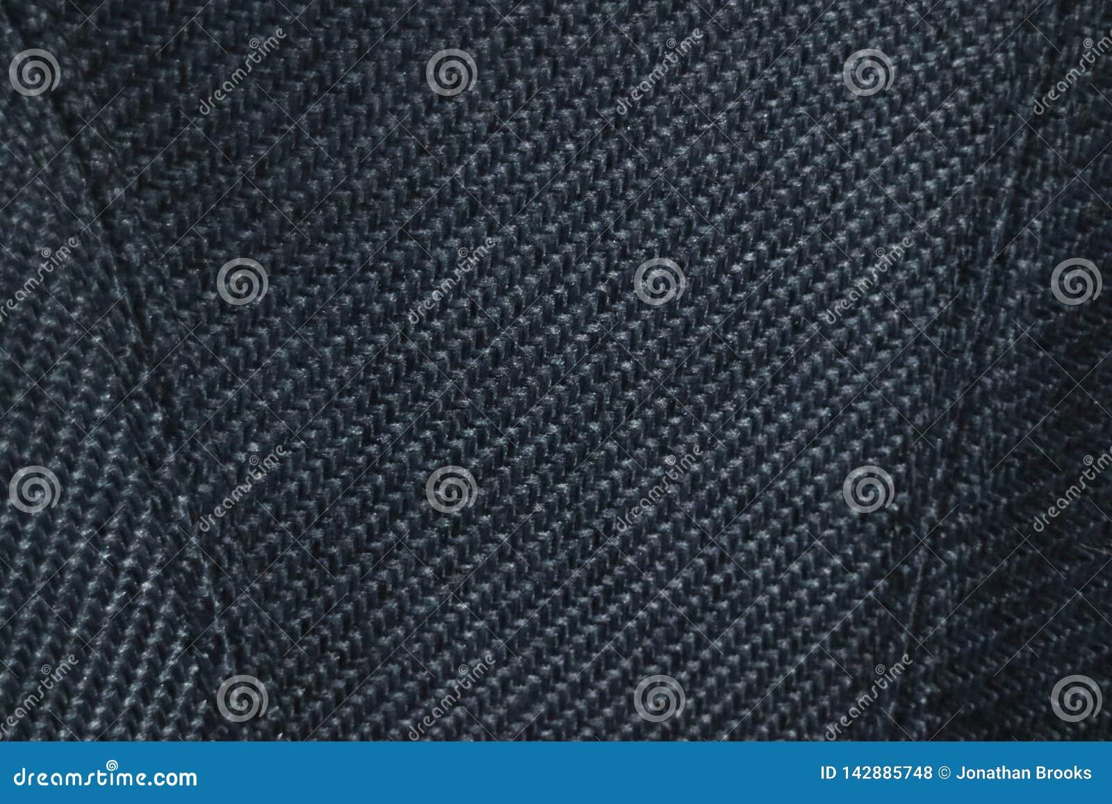 Clôturez la texture de tissu du fauteuil de luxe tapissé Piquer de la meilleure qualité et modèle croisé sur la surface de sofa