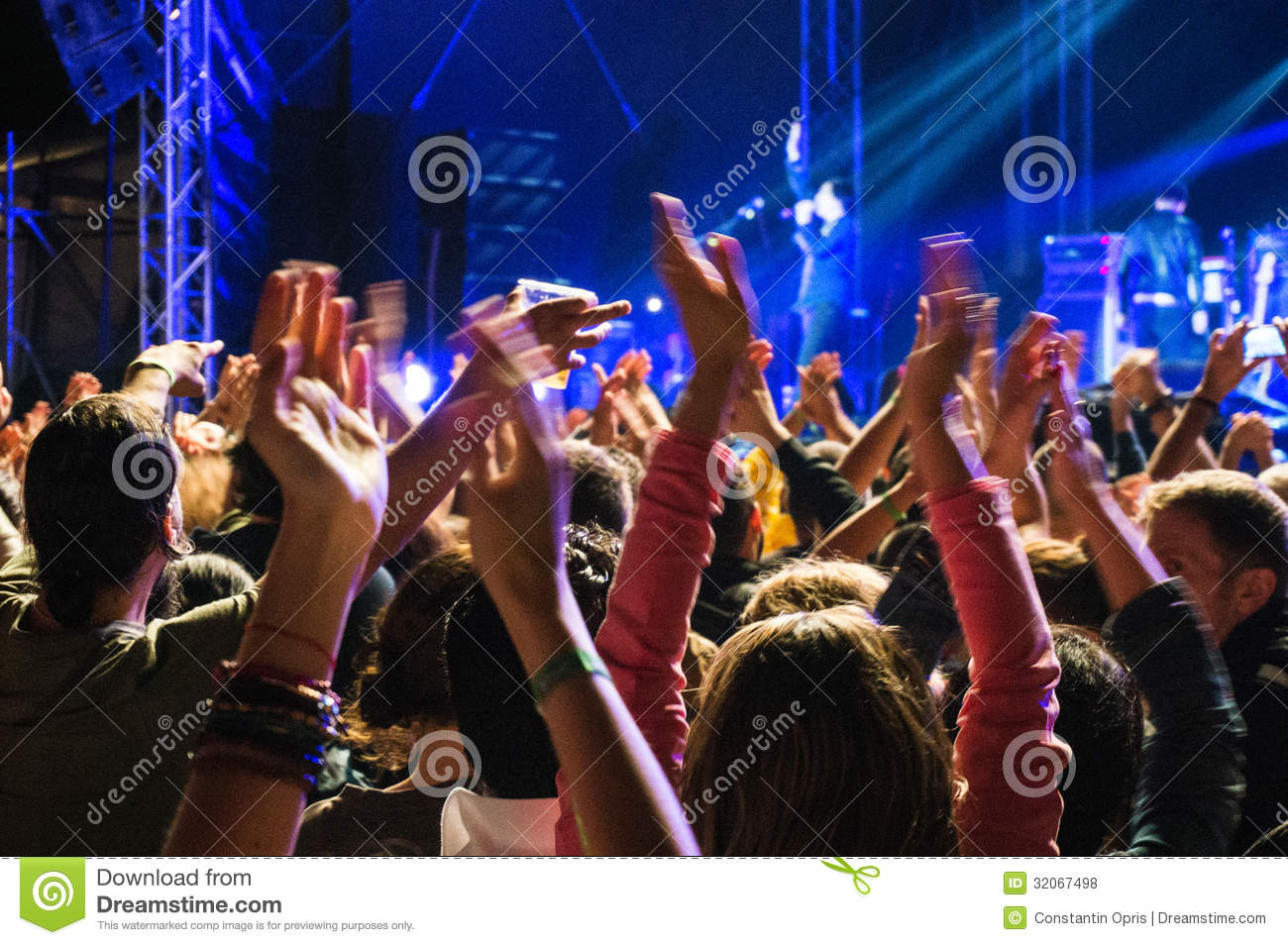 Clapping hands at concert