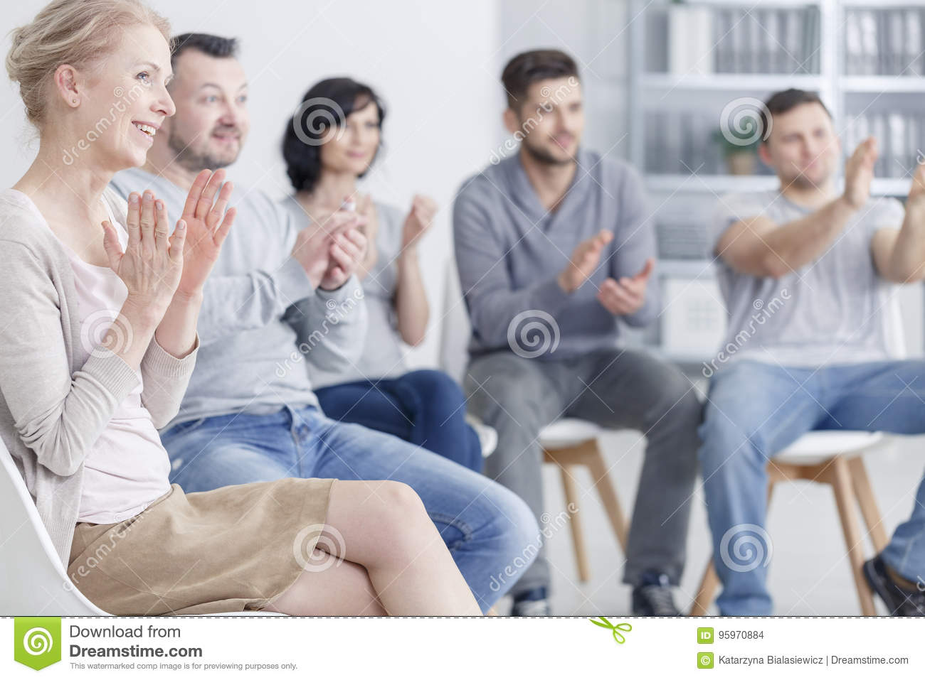 Clapping at support group meeting