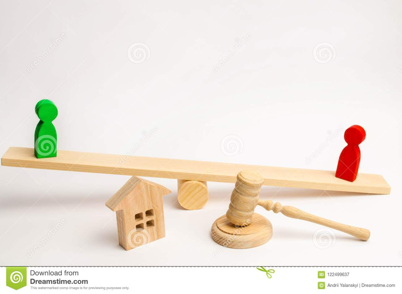 Clarification of ownership of the house. wooden figures of people. rivals in business stand on the scales. competitio, trial, conf