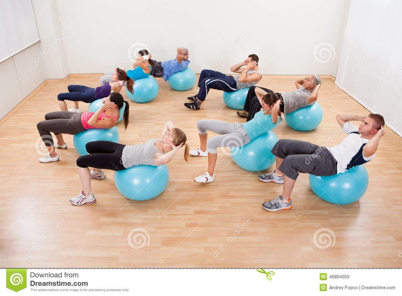 Class of diverse people doing pilates stock photo image for Gimnasio pilates