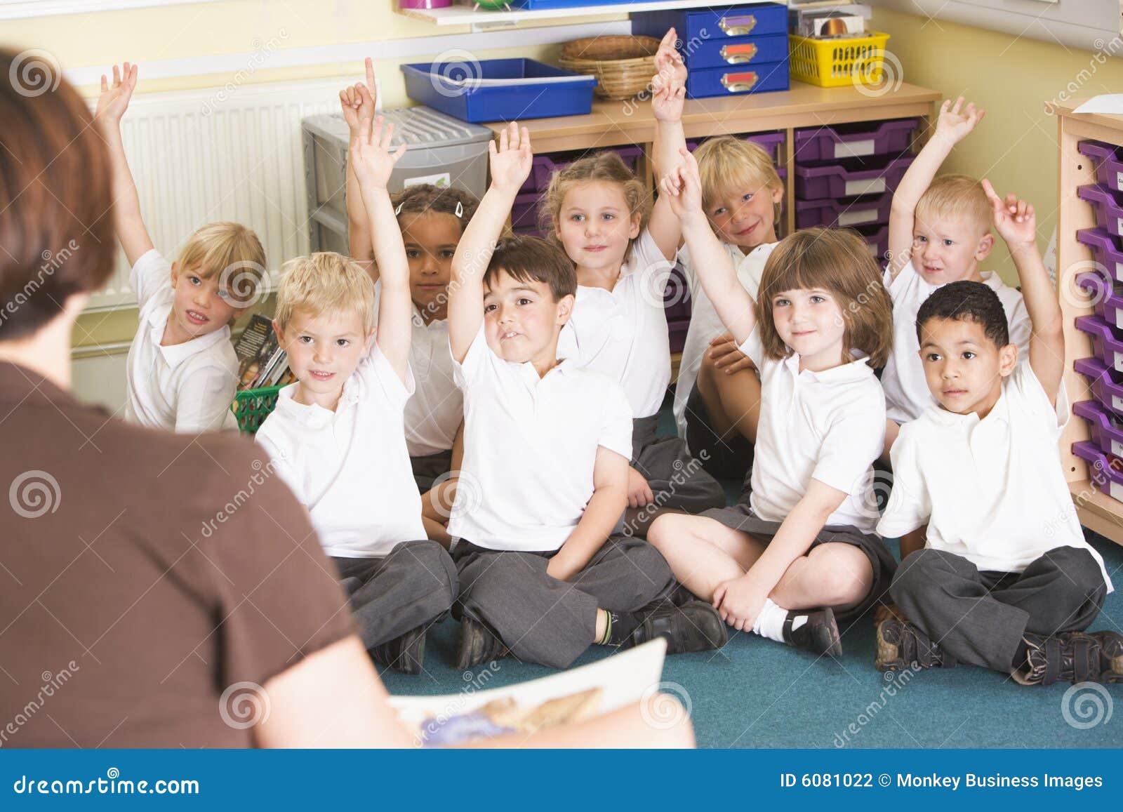 Class hand primary raise schoolchildren their