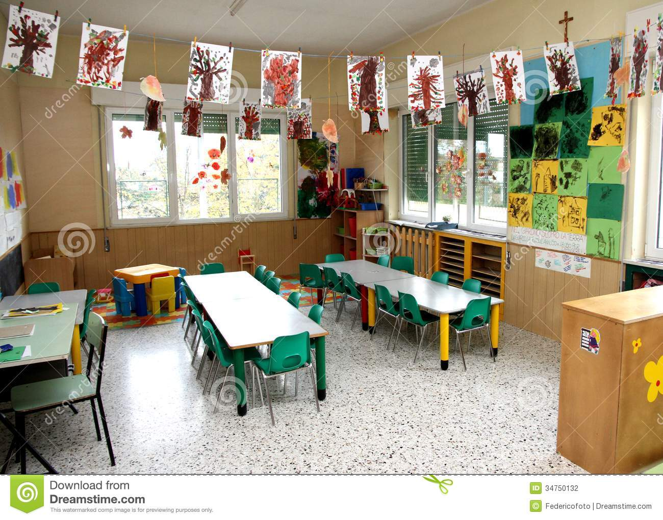 Nursery Class Of Children With Many Drawings Of Trees Hanging Fr Stock