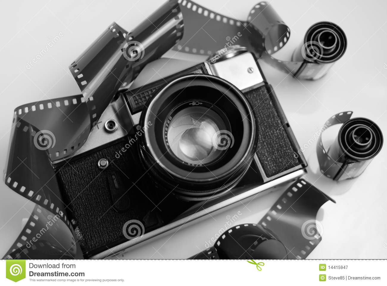 Black and white image of an old 35mm slr camera and film