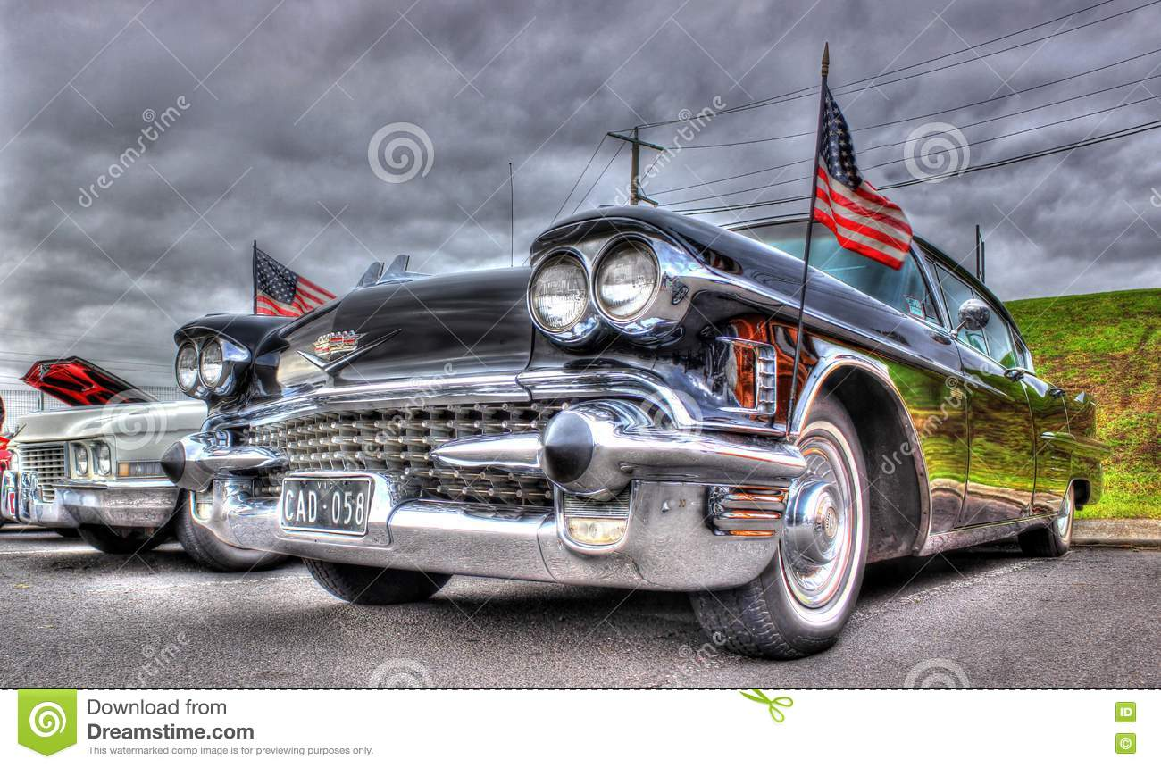 Classic American Black Cadillac And Flags Editorial Stock Image - Winters car show