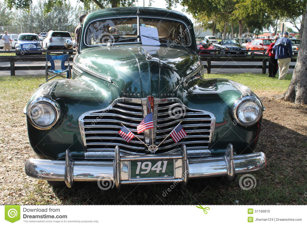 Classic American car front. 1941 Buick Special Eight sedan by a tree and  under the sun in sunny at a park south Florida.
