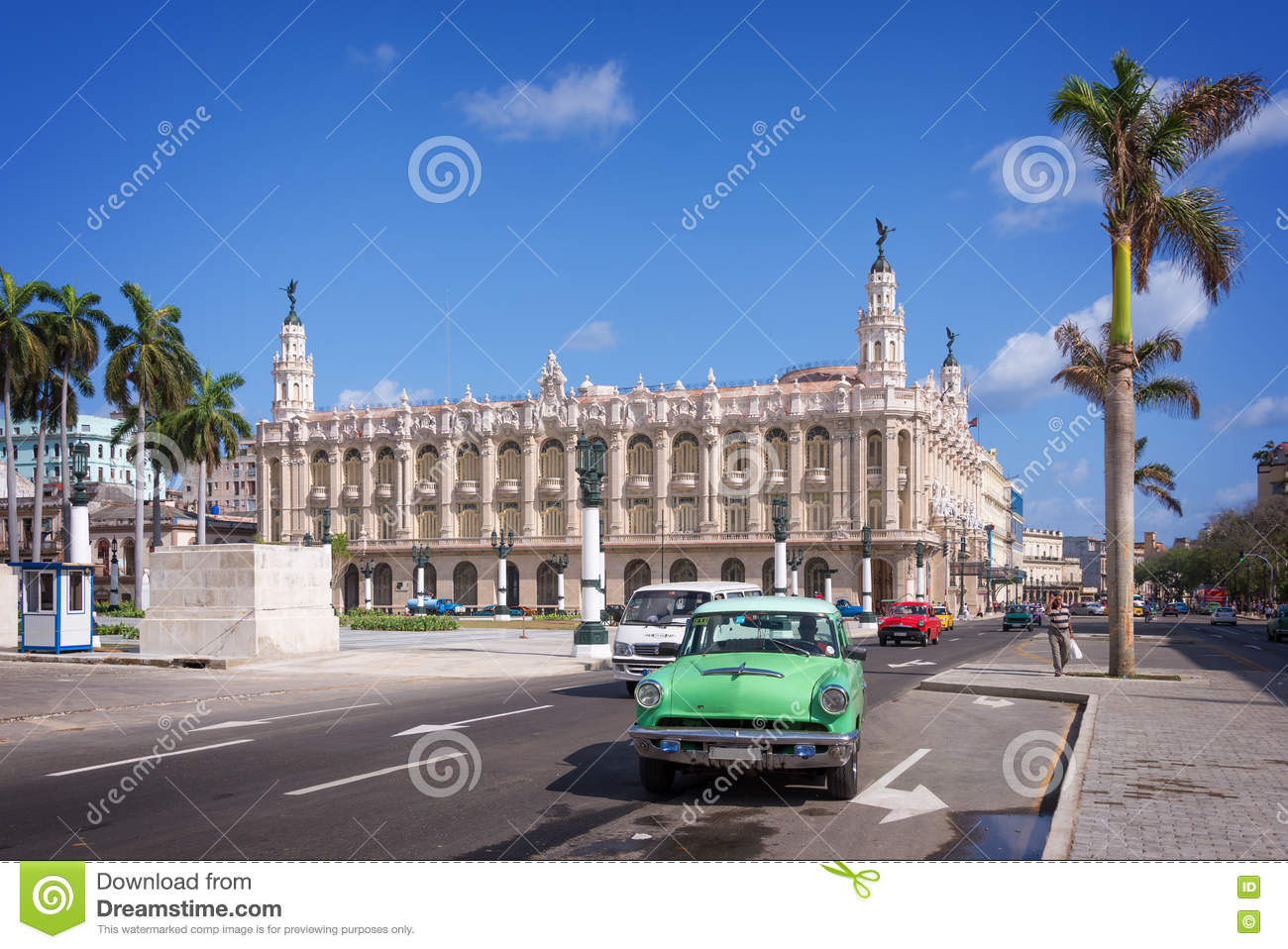 Classic american car on Paseo del Prado, Gran theatro de la Havana in the background