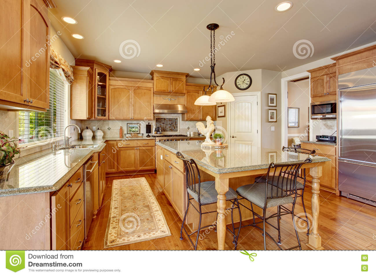 Classic American Kitchen Inerior With Brown Cabinets And ...