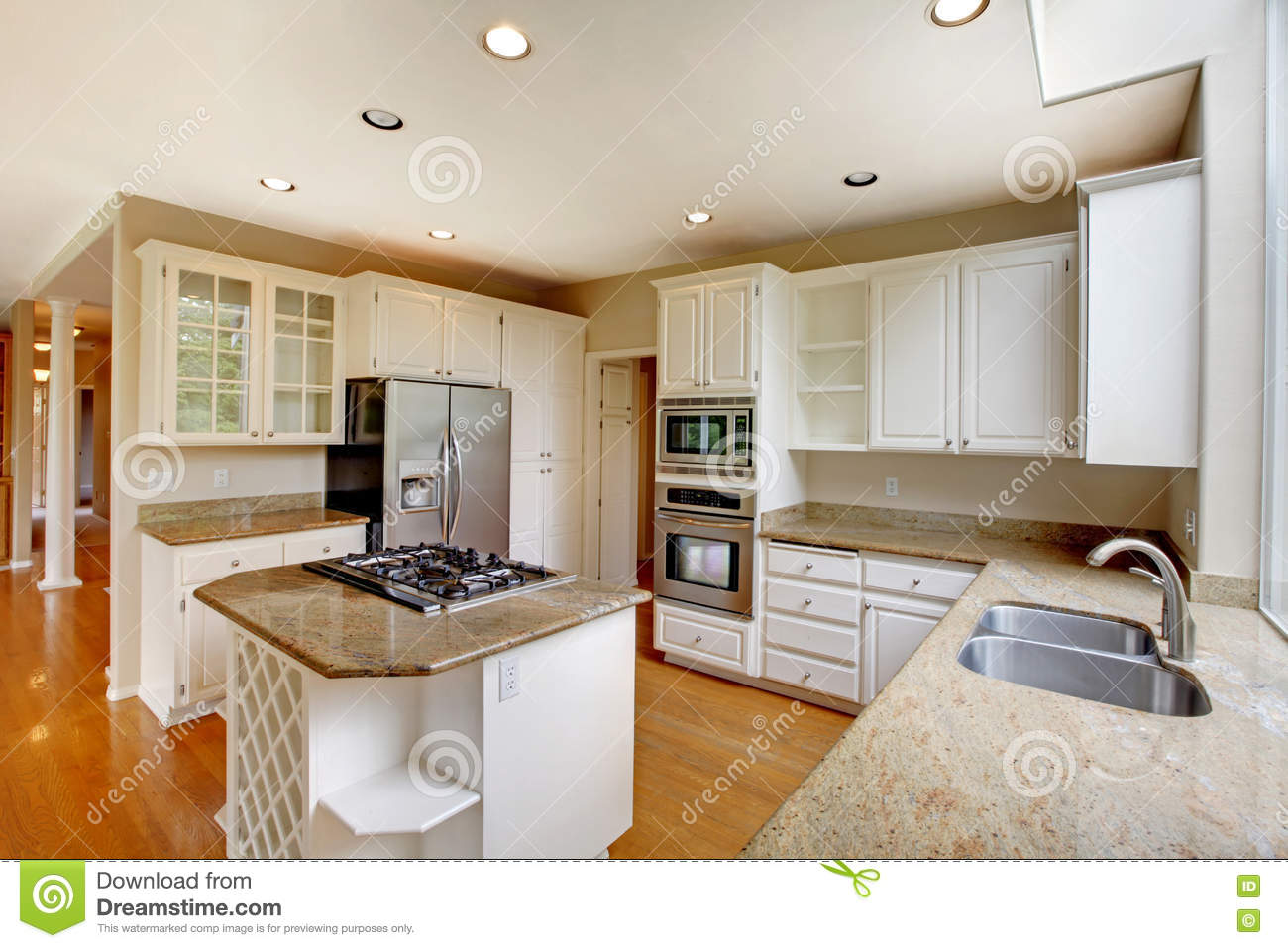 American kitchen and living room - Classic American Kitchen Interior With White Cabinets And Built In Stainless Steel Fridge