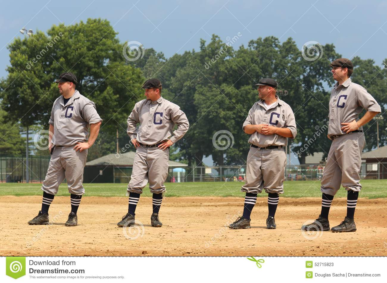 Vintage Baseball team lines up for pregame introductions at a vintage  baseball game, classic ballpark in summer amateur league, Midwest, United  States.
