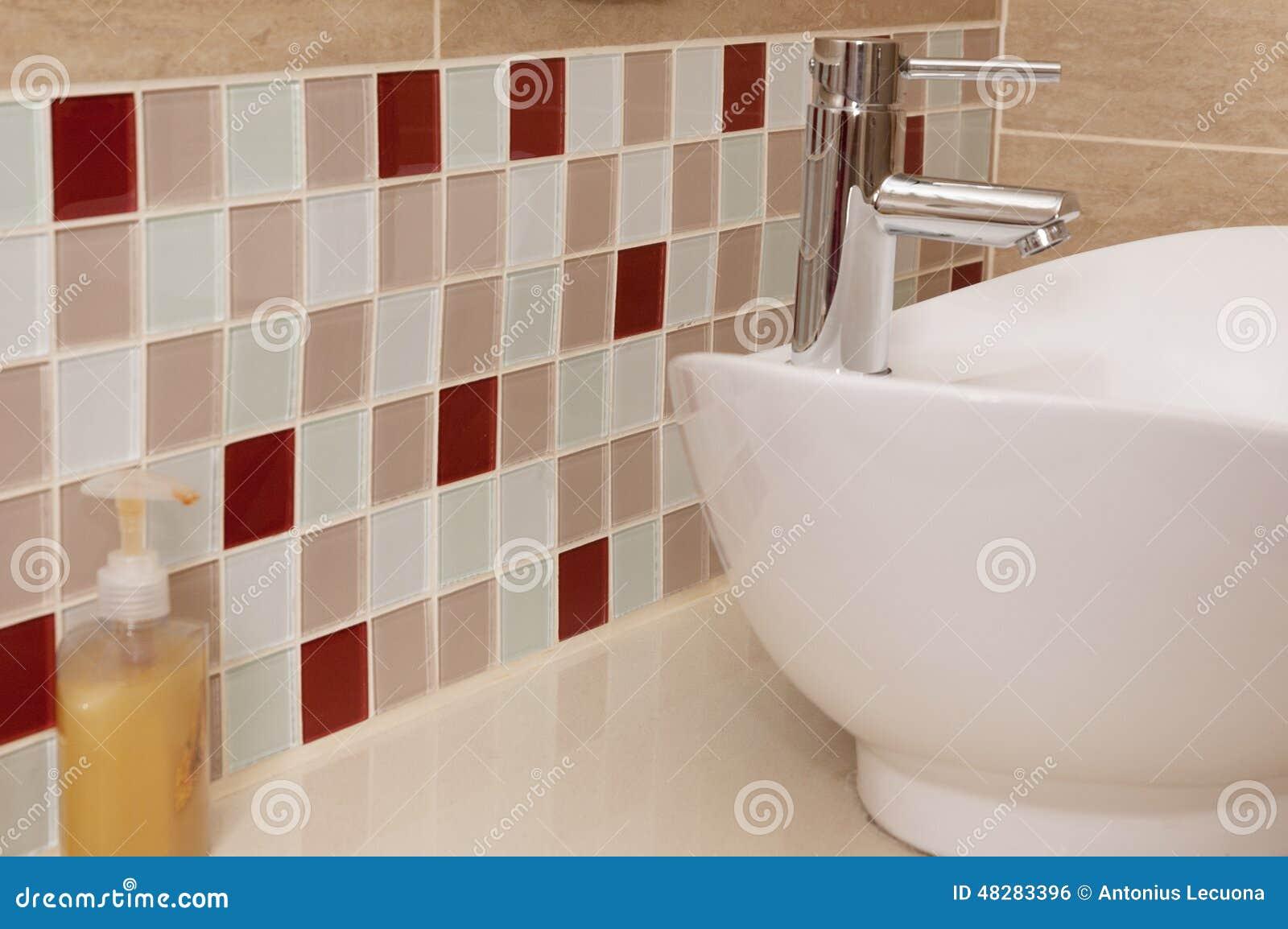 Classic Bathroom Sink With Coloured Mosaic Splashback