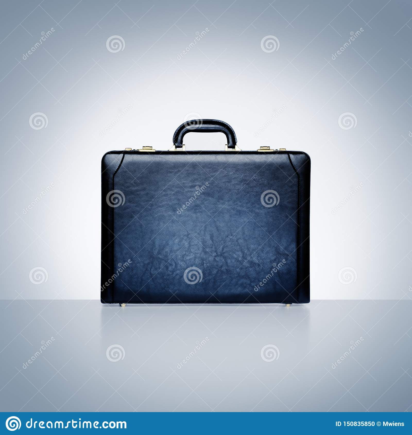 Black leather attache case on blue grey