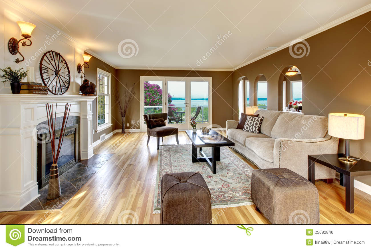 classic brown living room with white fireplace royalty free stock