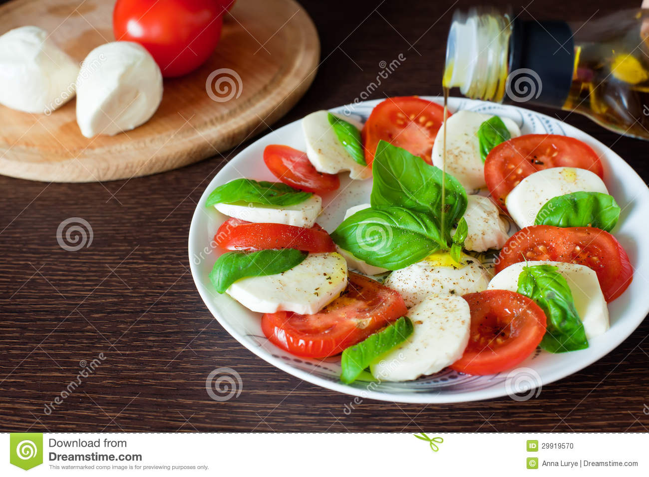 Classic Caprese salad with tomato,mozzarella, basil and olive oil ...