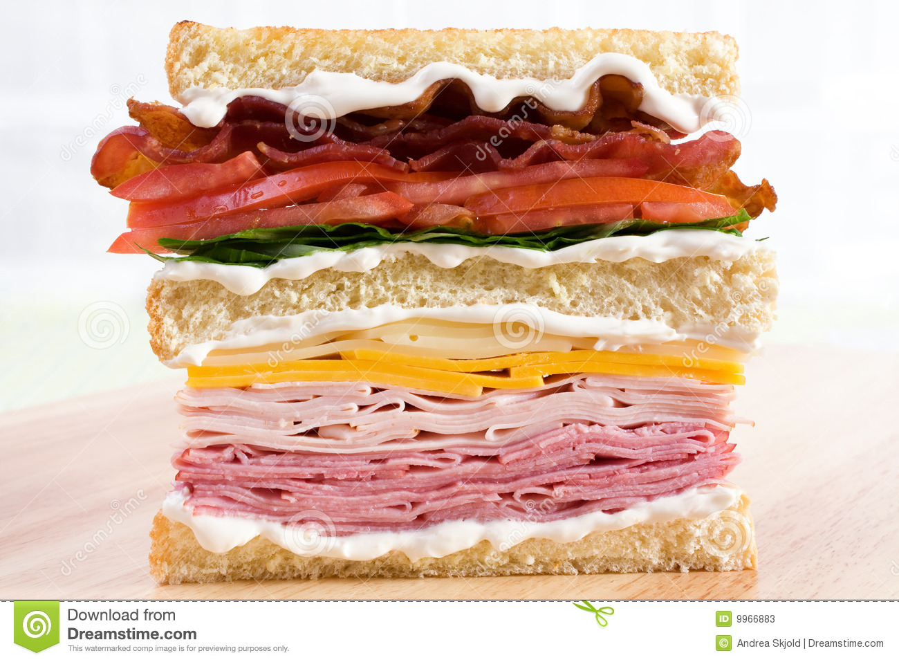 classic club sandwich with ham, turkey, cheddar cheese, swiss cheese ...