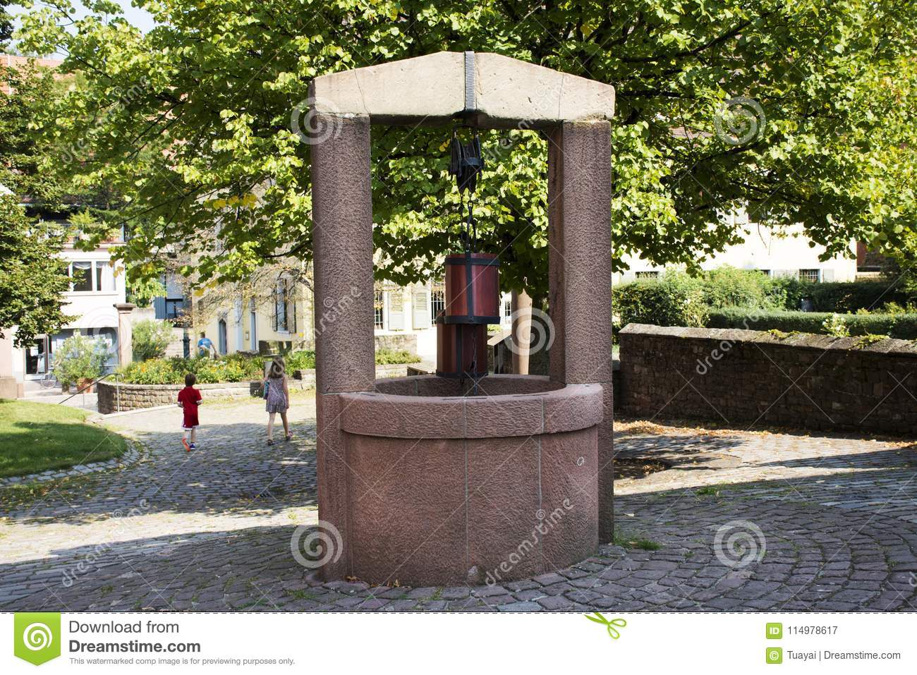 Classic dug water well at garden outdoor at Ladenburg town