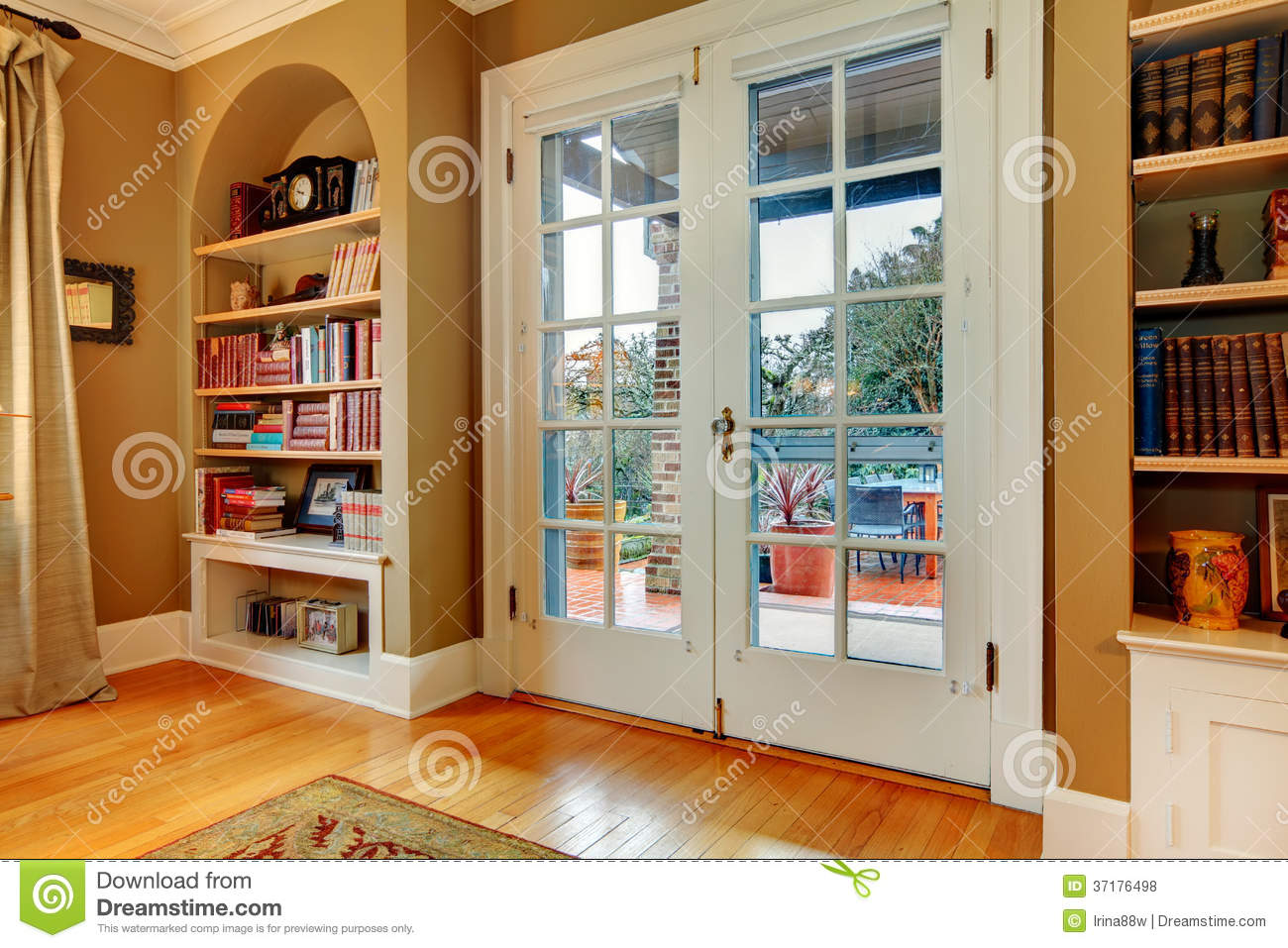Classic Entrance Hall With Wooden Glass Doors And Built In