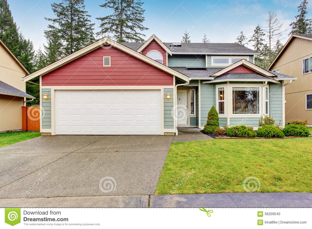 classic house with garage and driveway stock photo