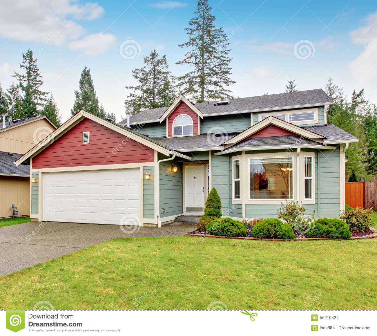 Classic House With Garage And Driveway. Stock Photo