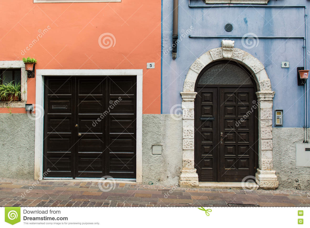 Classic Italy entrance doors on colorful wall