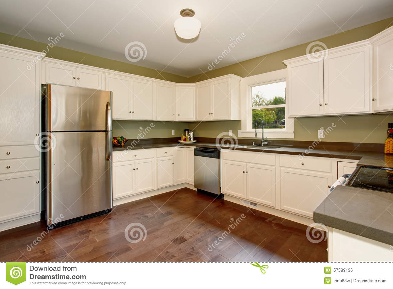 Large white and green kitchen with hardwood floor royalty for Kitchen interior paint
