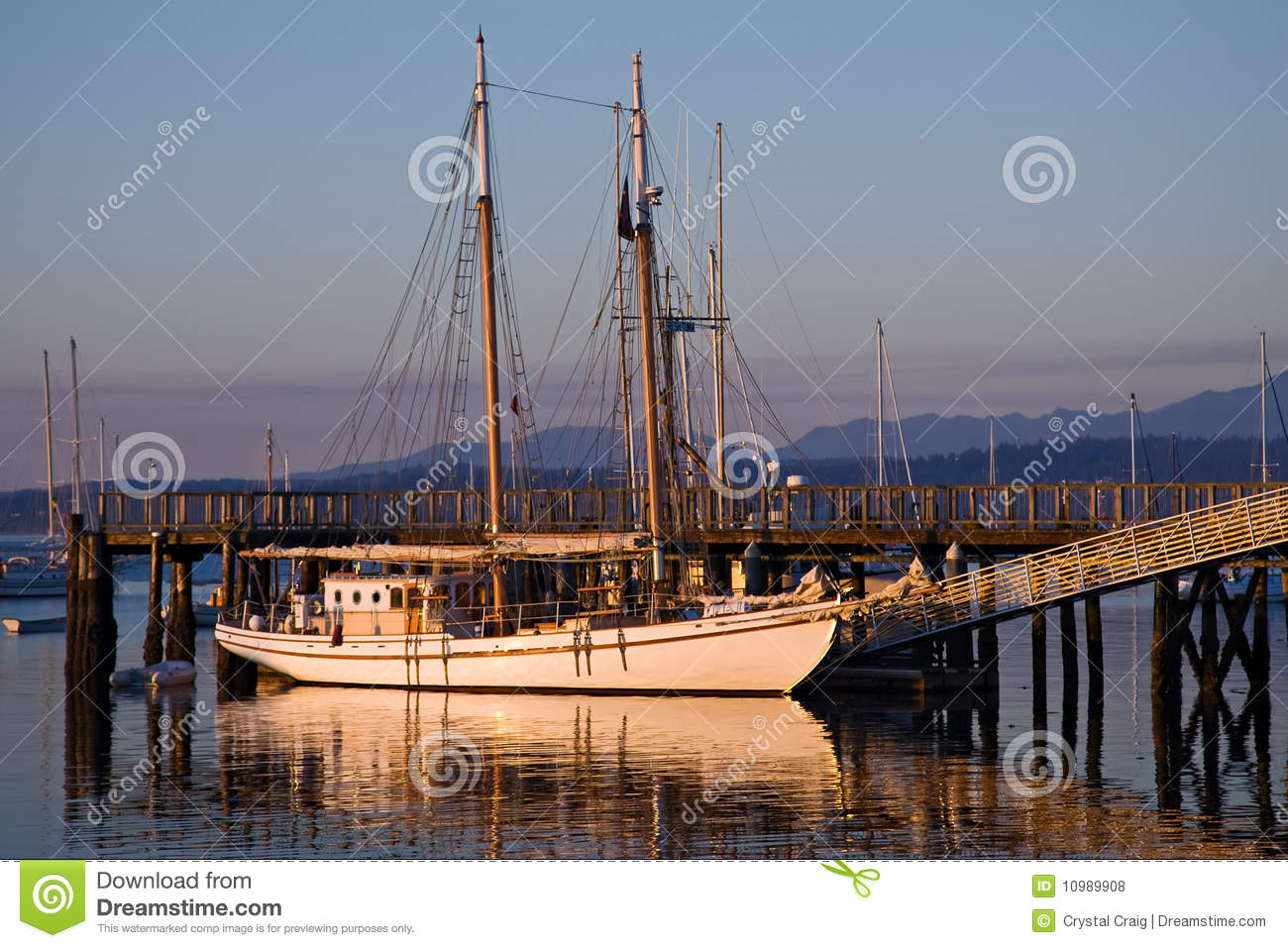 Large classic two mast gaff rigged wooden schooner sailboat docked in ...