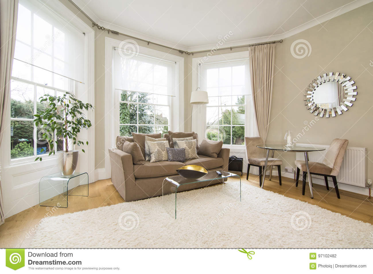 Classic Living Room With Large Bay Window Facing Lovely Garden