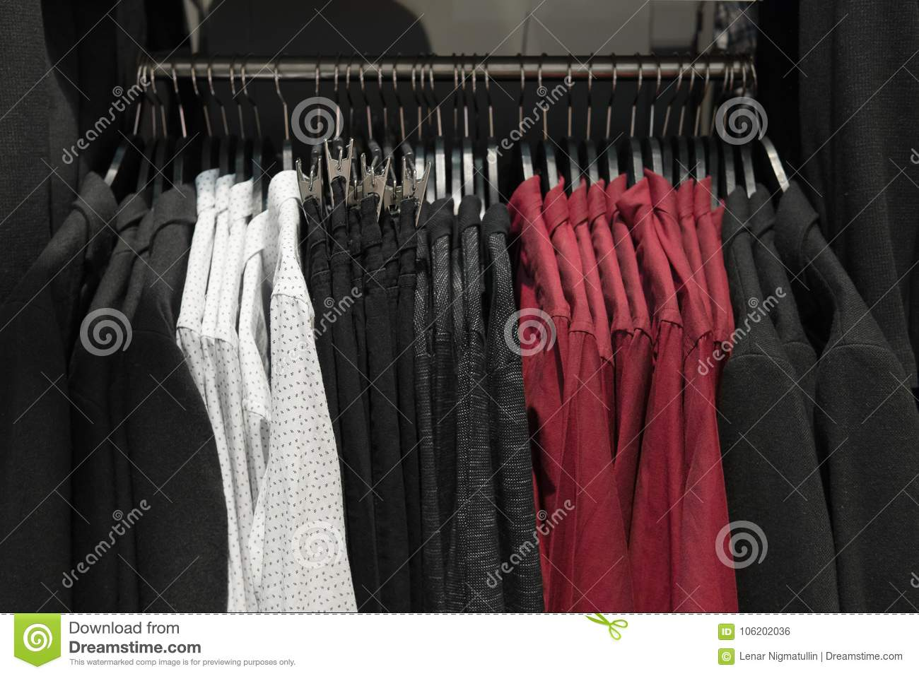 Classic Men Clothes, Suits, Shirts And Pants On The Racks In Clothing Store,  Shopping. Wardrobe Of Male Clothing On The Hanger, Fabric Textile