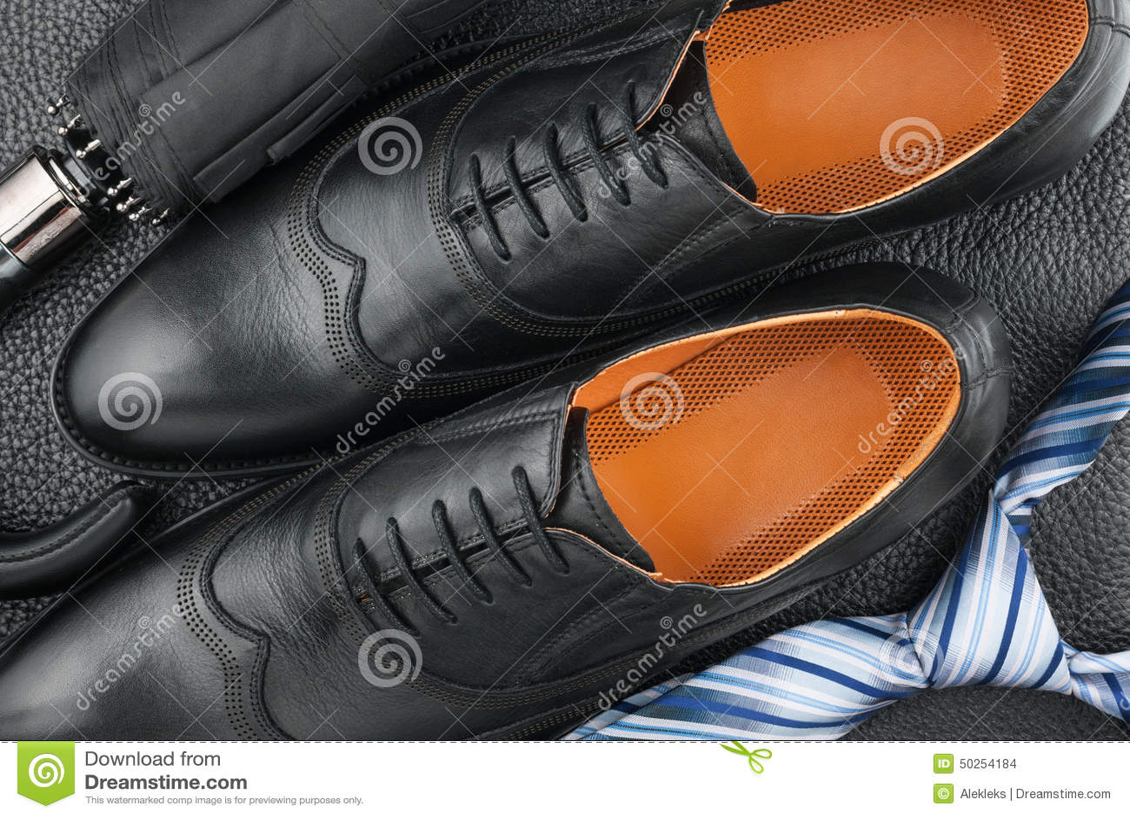 Classic mens shoes tie umbrella on the black leather stock photo classic men s shoes tie umbrella on the black leather ccuart Image collections