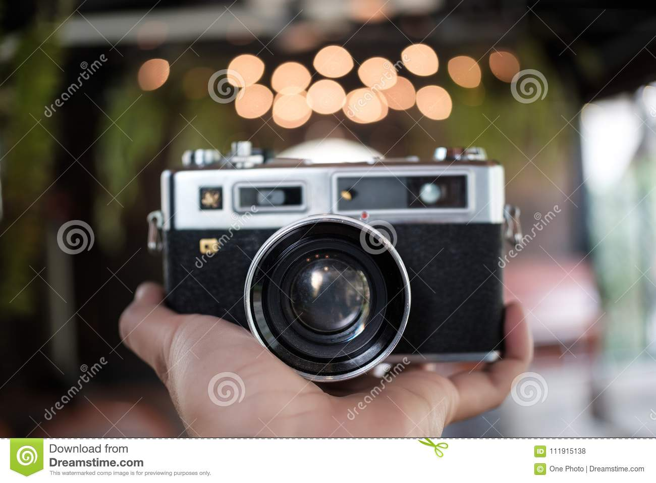 Classic old analog camera vintage color effect camera in hand