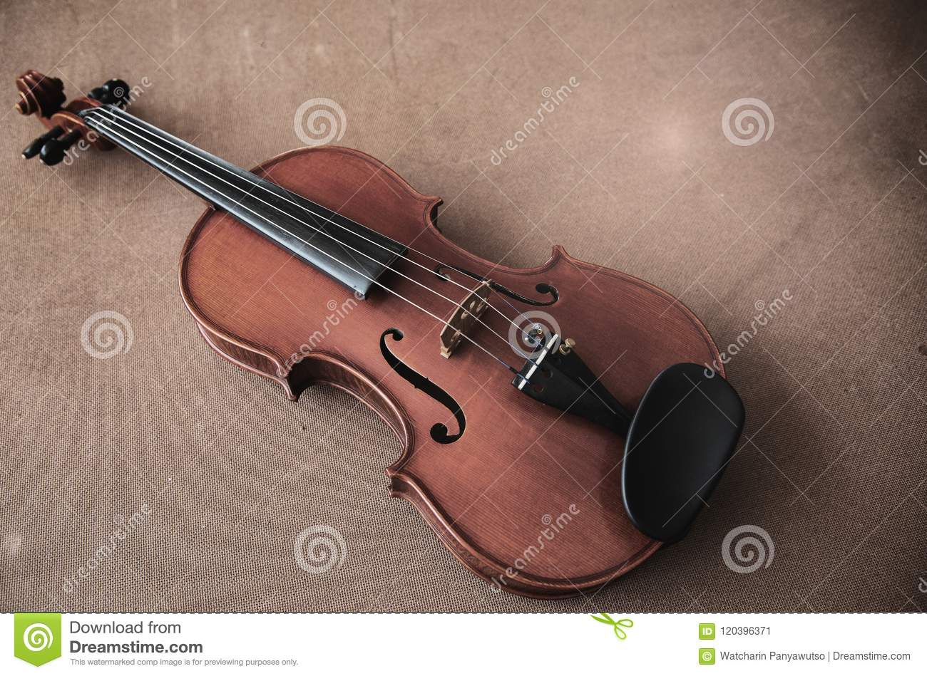 Violin on a colored knitted rug stock photo image of concept.