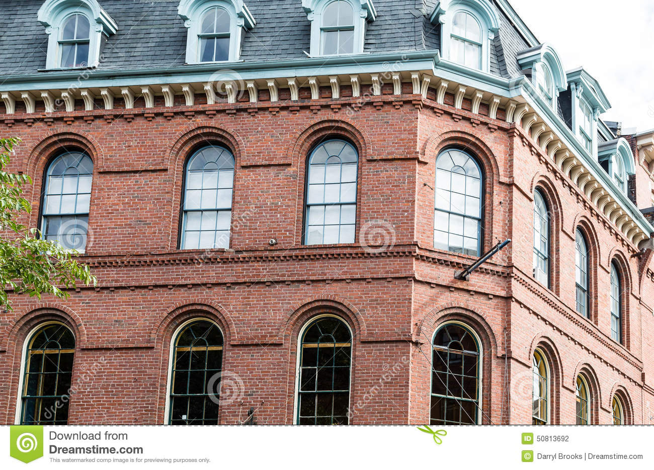 Windows on a red brick building royalty free stock photo for Brick house construction