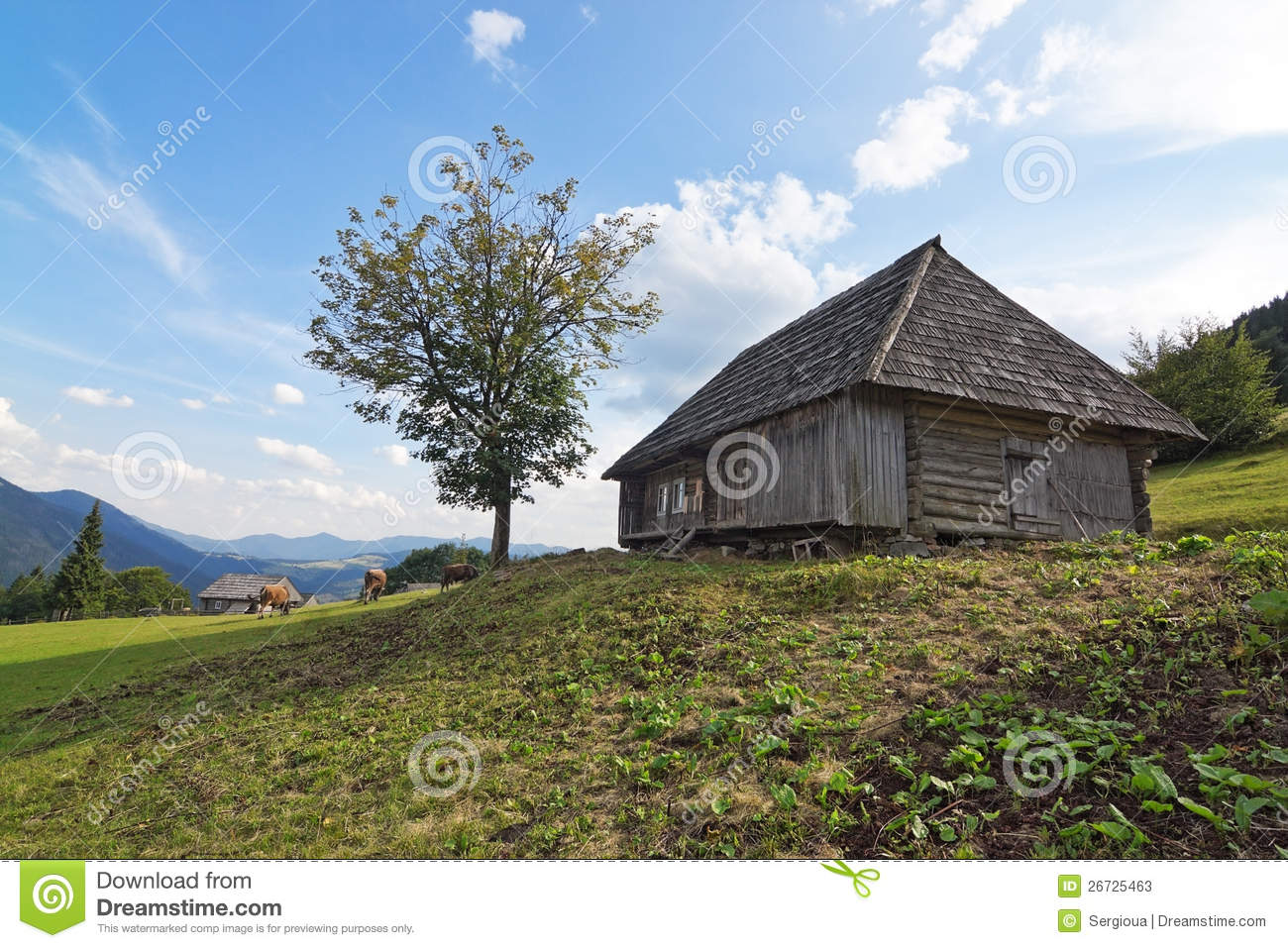 Classic old wooden house in a landscape stock photos for Classic house landscape