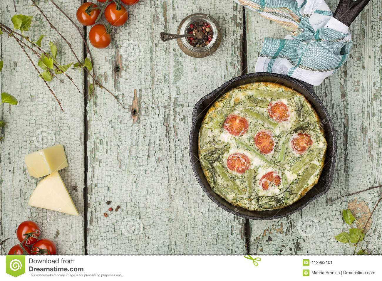 Classic omelet with cherry tomatoes, cheese and herbs
