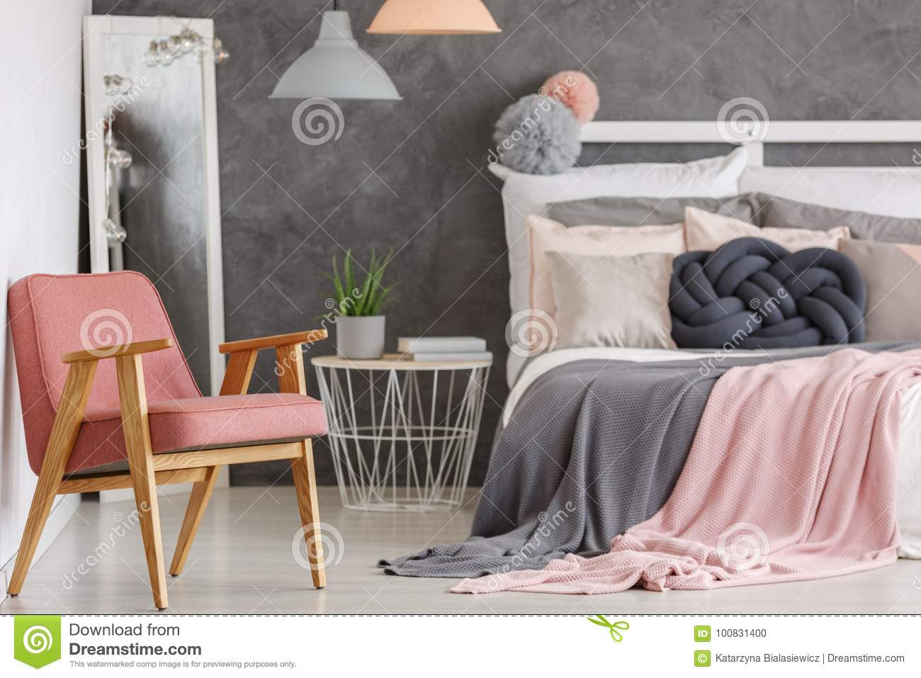 Pretty pink bedroom with chair