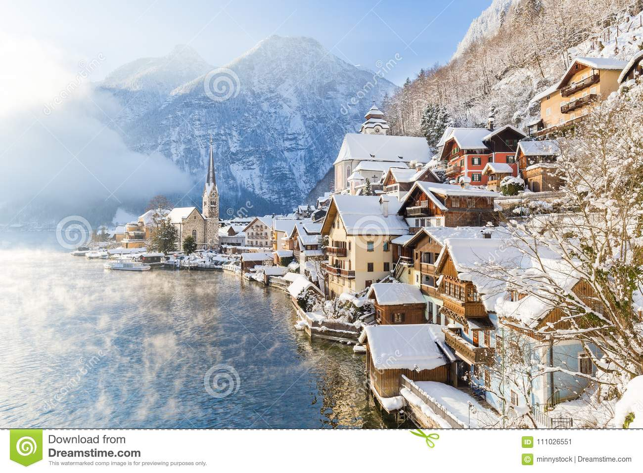 Classic view of Hallstatt with ship in winter, Salzkammergut, Au
