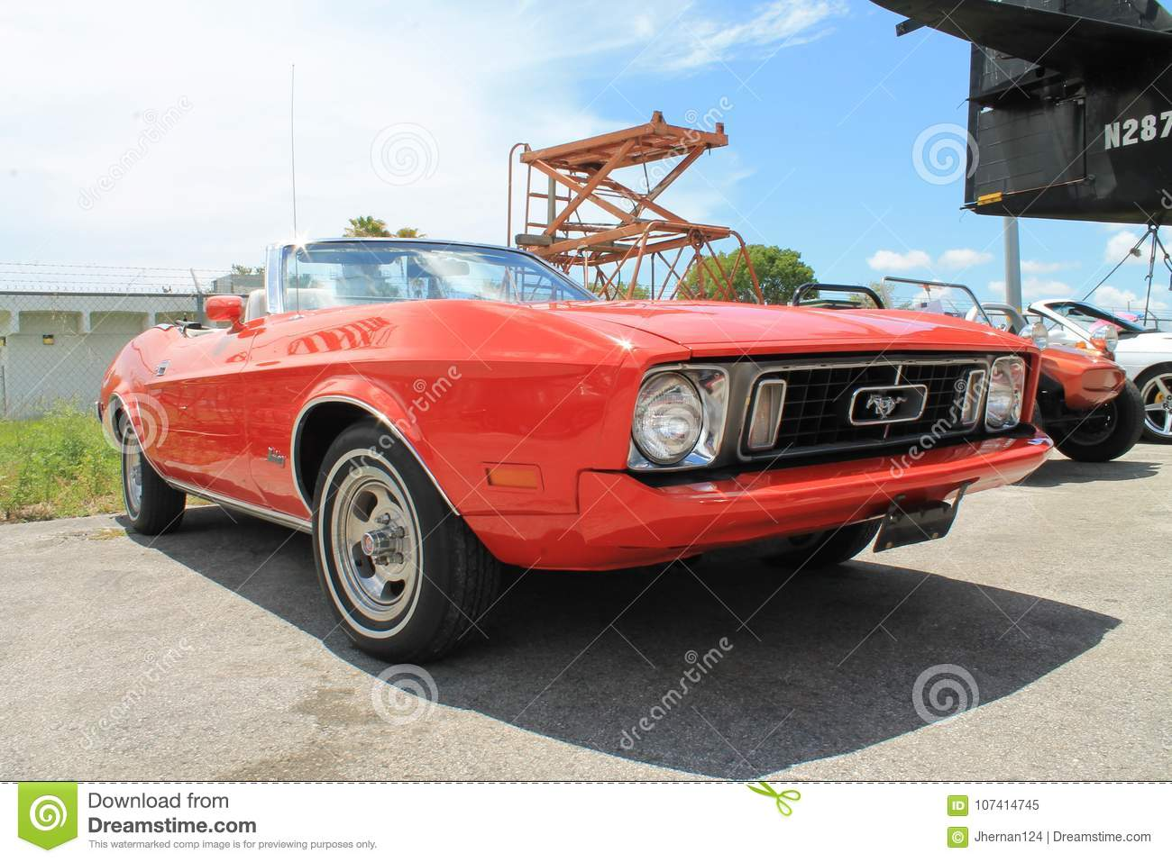 Classic red ford mustang convertible parked outdoors on a sunny day in south florida